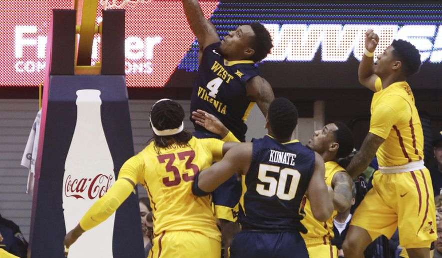 West Virginia guard Daxter Miles Jr. (4) dunks off an inbound play during the first half of the team's NCAA college basketball game against Iowa State, Friday, March 3, 2017, in Morgantown, W.Va. (AP Photo/Raymond Thompson)