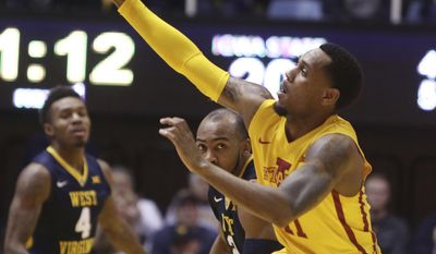 Iowa State guard Monte Morris (11) steals a pass during the first half of the team's NCAA college basketball game against West Virginia, Friday, March 3, 2017, in Morgantown, W.Va. (AP Photo/Raymond Thompson)
