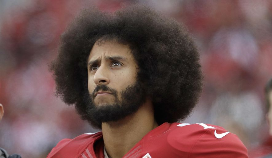 In this Dec. 11, 2016, file photo, San Francisco 49ers quarterback Colin Kaepernick stands in the bench area during the second half of the team's NFL football game against the New York Jets in Santa Clara, Calif. (AP Photo/Marcio Jose Sanchez, File)