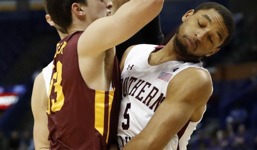 Loyola Chicago's Clayton Custer, left, heads to the basket as Southern Illinois' Leo Vincent defends during the first half of an NCAA college basketball game in the quarterfinals of the Missouri Valley Conference men's tournament Friday, March 3, 2017, in St. Louis. (AP Photo/Jeff Roberson)