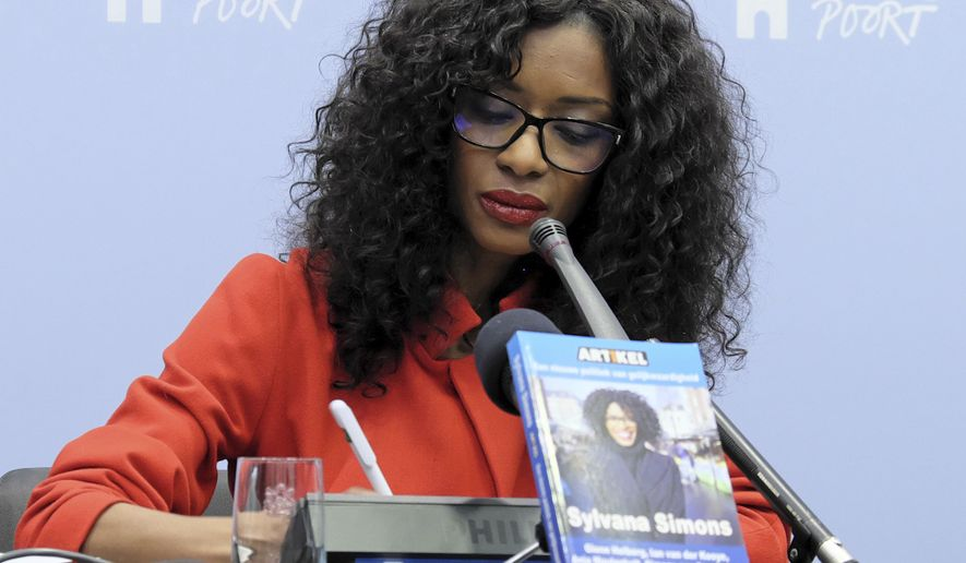 TV presenter Sylvana Simons listens to questions during a book presentation in The Hague, Netherlands, Friday, March 3, 2017. Simons is taking her campaign for equality in Dutch society into the country's Parliamentary elections. Simons, who is of Surinamese descent and last year endured a stream of online racial abuse, has named her party Article 1, after the opening paragraph of the Dutch constitution, which outlaws discrimination based on race, religion, gender or any other reason. (AP Photo/Mike Corder)