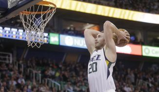 Utah Jazz forward Gordon Hayward goes up for a dunk against the Brooklyn Nets during the first half of an NBA basketball game Friday, March 3, 2017, in Salt Lake City. (AP Photo/Rick Bowmer)