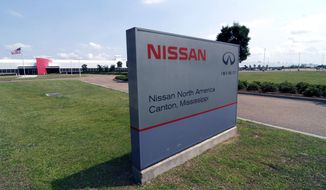 FILE - This sign photographed April 20, 2011, proclaims the location of the Nissan auto manufacturing facility in Canton, Miss. The United Auto Workers union charges Friday, March 3, 2017, that Nissan Motor Co. broke federal labor law hours less than two days before a Saturday rally in Mississippi where U.S. Sen. Bernie Sanders and others plan to speak in favor of unionization. The UAW says that on Thursday, a company security guard wrongfully stopped workers from handing out literature and asking fellow employees to authorize a union vote outside a gate of the Canton plant. (AP Photo/Rogelio V. Solis, File)