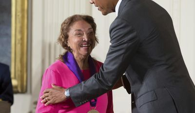 FILE - In this Sept. 10, 2015, file photo, President Barack Obama awards the 2014 National Medal of Arts to actress, theater founder, and director Miriam Colon of New York during a ceremony in the East Room at the White House in Washington. Colon, an icon in U.S. Latino theater who starred in films alongside Marlon Brando and Al Pacino, has died at age 80. Her husband, Fred Valle, told The Associated Press that Colon died early Friday, March 3, 2017, because of complications from a pulmonary infection. (AP Photo/Andrew Harnik, File)