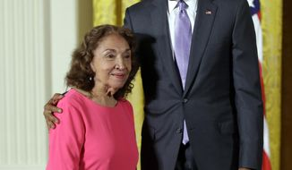 FILE - In this Sept. 10, 2015, file photo, President Barack Obama awards the 2014 National Medal of Arts to actress, theater founder, and director Miriam Colon of New York, during a ceremony in the East Room at the White House in Washington. Colon, an icon in U.S. Latino theater who starred in films alongside Marlon Brando and Al Pacino, has died at age 80. Her husband, Fred Valle, told The Associated Press that Colon died early Friday, March 3, 2017, because of complications from a pulmonary infection. (AP Photo/Manuel Balce Ceneta, file)