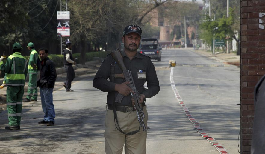 A Pakistani police officer stands guard at an entry gate of Gaddafi stadium ahead of the final cricket match of Pakistan Super League, in Lahore, Pakistan, Thursday, March 02, 2017. It is supposed to be just a domestic Twenty20 final. But for the Pakistan Cricket Board it's a challenge to showcase the world that it's safe to play international sports in Pakistan. With just three days to go before Sunday's Pakistan Super League final at the Gaddafi Stadium, still nobody is sure which eight foreign players will put aside their security fears and will eventually play the marquee match at the Gaddafi Stadium. (AP Photo/K.M. Chaudary)