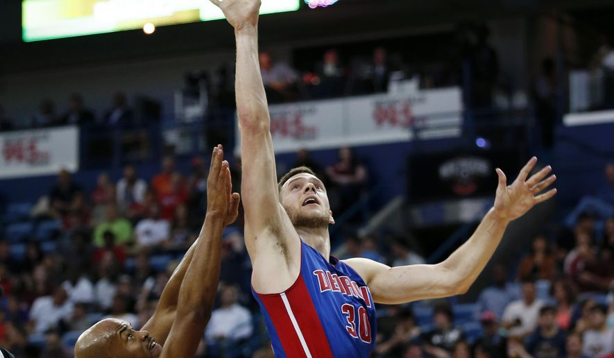 Detroit Pistons forward Jon Leuer (30) goes to the basket against New Orleans Pelicans guard Jarrett Jack (1) during the first half of an NBA basketball game in New Orleans, Wednesday, March 1, 2017. (AP Photo/Gerald Herbert)