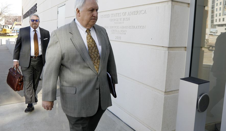 Former State Sen. Irb Benjamin of Madison, foreground, leads his attorney Joe Hollomon, to the federal courthouse in Jackson, Miss., for sentencing after having pleaded guilty to paying bribes for prison contracts to former state Corrections Commissioner Chris Epps, Friday, March 3, 2017. Benjamin faces up to 10 years in prison and up to $250,000 in fines. (AP Photo/Rogelio V. Solis)