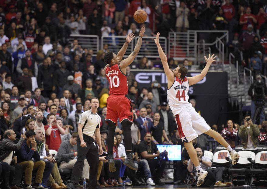 Toronto Raptors guard DeMar DeRozan (10) shoots against Washington Wizards guard Bojan Bogdanovic (44) during the second half of an NBA basketball game, Friday, March 3, 2017, in Washington. The Raptors won 114-106.(AP Photo/Nick Wass)