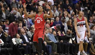 Toronto Raptors guard DeMar DeRozan (10) reacts after he scored a 3-pointer during the second half of an NBA basketball game as Washington Wizards guard Bojan Bogdanovic (44) looks away, Friday, March 3, 2017, in Washington. The Raptors won 114-106.(AP Photo/Nick Wass)