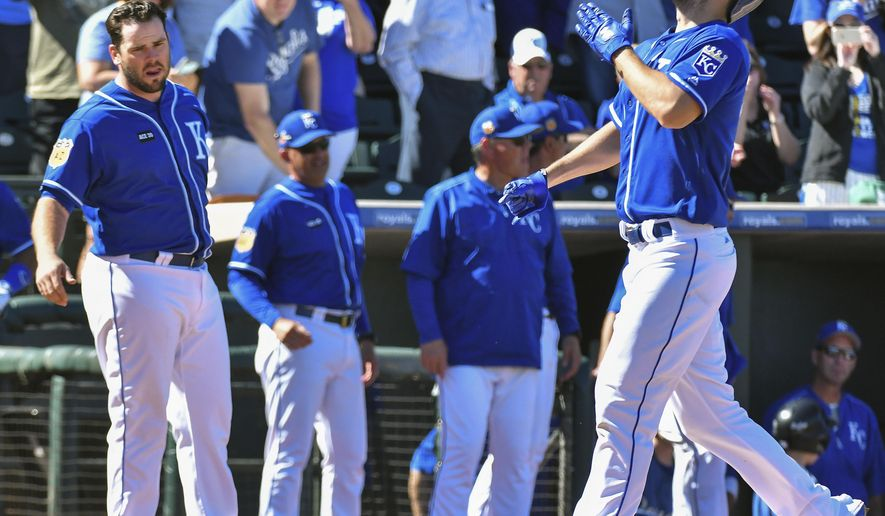 Kansas City Royals' Eric Hosmer celebrates his two-run home run against the Colorado Rockies during the fourth inning of a spring training baseball game Thursday, March 2, 2017, in Surprise, Ariz. (John Sleezer/The Kansas City Star via AP)