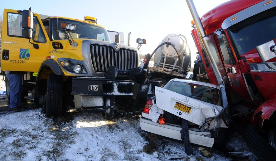 A car is wedged between a PennDOT truck and a tractor-trailer Friday, March 3, 2017.  Several Pennsylvania interstates are closed and numerous injuries have been reported as police respond to weather-related crashes and pileups. The Pennsylvania Department of Transportation says snow squalls moving across the state led to several multi-vehicle wrecks Friday. A pileup on Interstate 81 in Schuylkill County has sent multiple people to the hospital. (Frank Andruscavage/Republican-Herald via AP)