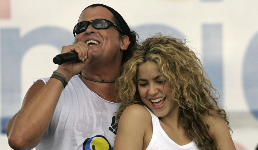 "In this July 20, 2008, file photo, Colombian singers Shakira, right, and Carlos Vives perform during a ""concert for peace"" Independence Day celebrations in Leticia, Colombia. (AP Photo/William Fernando Martinez, File)"
