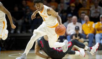 FILE - In this Feb. 11, 2017, file photo, Tennessee's Robert Hubbs III (3) dribbles the ball during an NCAA college basketball game against Georgia in Knoxville, Tenn. Barring a dramatic run in the Southeastern Conference tournament, Hubbs, a former five-star prospect, won't ever get the chance to play in an NCAA Tournament game during his four-year career. Yet this 1,000-point scorer still has left a mark on the program by the way he's led a team that relies heavily on underclassmen. (Calvin Mattheis/Knoxville News Sentinel via AP, File)/Knoxville News Sentinel via AP)