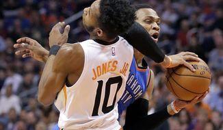 Oklahoma City Thunder guard Russell Westbrook fouls Phoenix Suns forward Derrick Jones Jr. (10) during the first half of an NBA basketball game, Friday, March 3, 2017, in Phoenix. (AP Photo/Matt York)