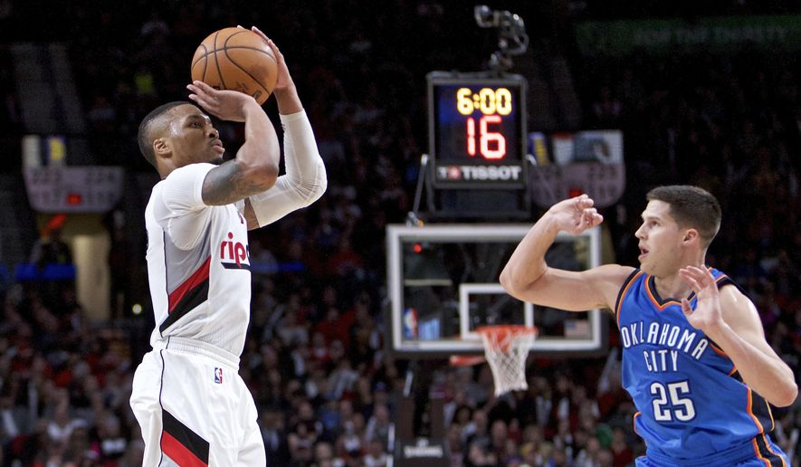 Portland Trail Blazers guard Damian Lillard, left, shoots over Oklahoma City Thunder forward Doug McDermott during the second half of an NBA basketball game in Portland, Ore., Thursday, March 2, 2017. (AP Photo/Craig Mitchelldyer)