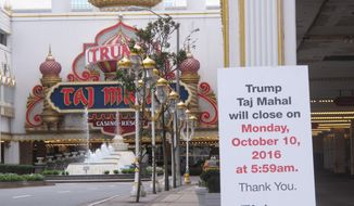 This Oct. 5, 2016 photo shows a sign outside the Trump Taj Mahal casino in Atlantic City N.J. warning that the casino is to shut down on Monday Oct. 10. On March 1, 2017, billionaire investor Carl Icahn sold the shuttered casino to Hard Rock International, which plans to rebrand and reopen it. (AP Photo/Wayne Parry)