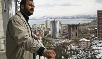 In this Friday, Feb. 17, 2017 photo, Suleiman Herwis, 50, a Libyan national, who lives in Riyadh, Saudi Arabia, stands on the balcony of his recently purchased flat, in the Black Sea region town of Fatsa, Turkey. The Saudi Arabia-based physician says he is looking forward to vacations in this remote but more conservative part of Turkey, an area largely bypassed by Western tourists. (AP Photo/Neyran Elden)