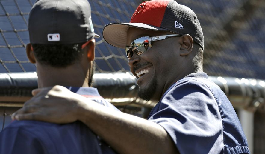 Minnesota Twins hitting coach James Rowson, right, laughs as he talks to center fielder Danny Santana before a spring training baseball game against the Philadelphia Phillies Friday, March 3, 2017, in Clearwater, Fla. (AP Photo/Chris O'Meara)