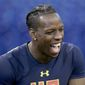 Washington wide receiver John Ross is seen after a drill at the 2017 NFL football scouting combine Saturday, March 4, 2017, in Indianapolis. (AP Photo/Gregory Payan)