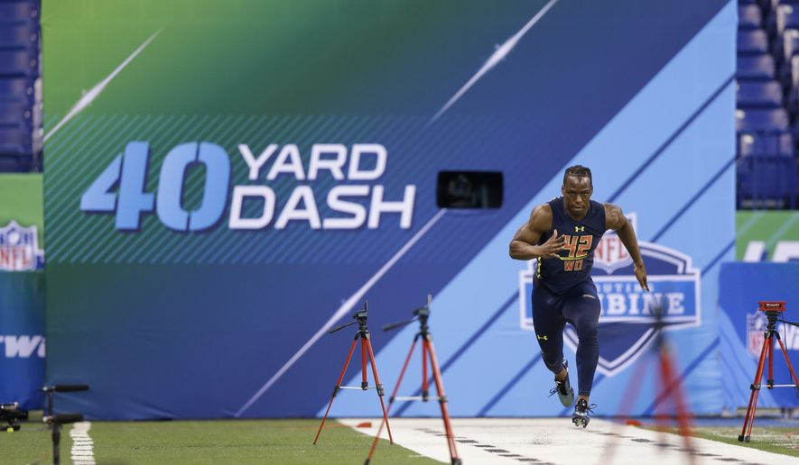 Washington wide receiver John Ross runs the 40-yard dash at the NFL football scouting combine in Indianapolis, Saturday, March 4, 2017. (AP Photo/Michael Conroy)