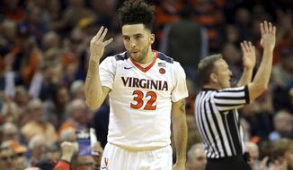 Virginia guard London Perrantes (32) celebrates making a three-point shot during the first half of an NCAA college basketball game against Pittsburgh, Saturday, March 4, 2017, in Charlottesville, Va. (AP Photo/Ryan M. Kelly)