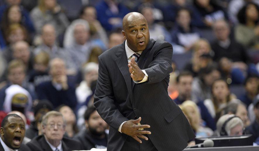 Georgetown head coach John Thompson III gestures during the second half of an NCAA college basketball game against Villanova, Saturday, March 4, 2017, in Washington. Villanova won 81-55. (AP Photo/Nick Wass)