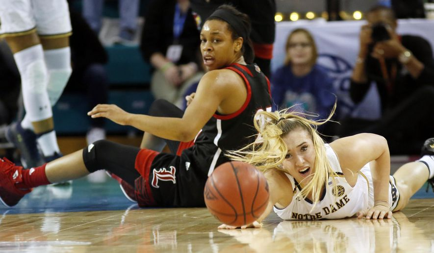 Notre Dame's Marina Mabrey, right, falls on the floor going for the ball against Louisville's Asia Durr, left, during the first half of an NCAA college basketball game in the Atlantic Coast Conference tournament at the HTC Center in Conway, S.C., Saturday, March 4, 2017. (AP Photo/Mic Smith)