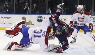 New York Rangers right wing Rick Nash (61) collides with Montreal Canadiens goalie Carey Price (31) during the second period of an NHL hockey game, Saturday, March 4, 2017, in New York. (AP Photo/Julie Jacobson)