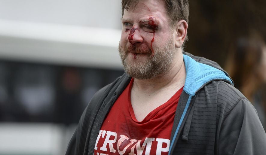 A Trump supporter was injured in a rally last month that attracted hundreds of pro-Trump supporters and opponents near the University of California, Berkeley. (Associated Press/File)