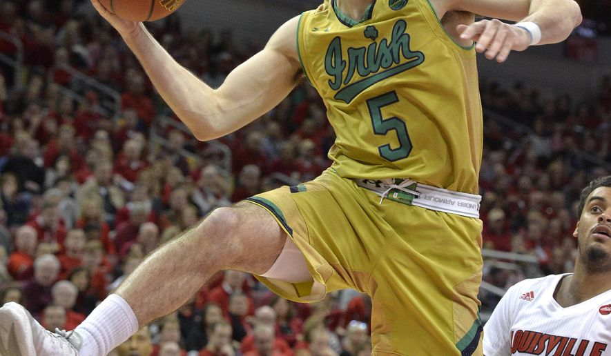 Notre Dame's Matt Farrell (5) looks to pass the ball during the first half of an NCAA college basketball game against Louisville, Saturday, March 4, 2017, in Louisville, Ky. (AP Photo/Timothy D. Easley)