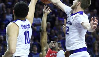 Kansas State forwards Dean Wade (32) and Isaiah Maurice (10) block a shot by Texas Tech guard Keenan Evans (12) during the first half of an NCAA college basketball game in Manhattan, Kan., Saturday, March 4, 2017. (AP Photo/Orlin Wagner)