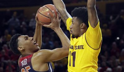 Arizona guard Allonzo Trier (35) draws the foul from Arizona State guard Shannon Evans II during the first half of an NCAA college basketball game, Saturday, March 4, 2017, in Tempe, Ariz. (AP Photo/Rick Scuteri)