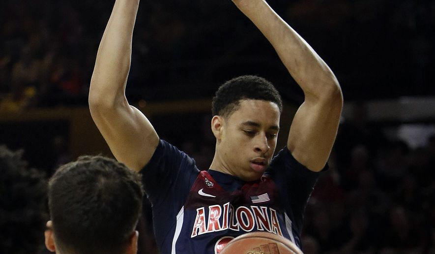 Arizona center Chance Comanche (21) dunks the ball over Arizona State forward Ramon Vila during the first half of an NCAA college basketball game, Saturday, March 4, 2017, in Tempe, Ariz. (AP Photo/Rick Scuteri)