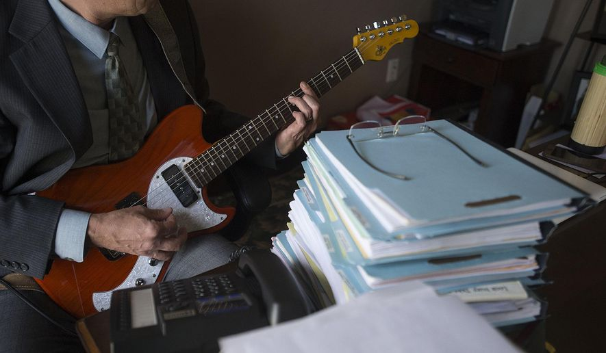 In this Tuesday, Nov. 15, 2016 photo, Michael Green, a criminal defense attorney and musician, is pictured in his office in downtown Vancouver, Wash.(Amanda Cowan /The Columbian via AP)