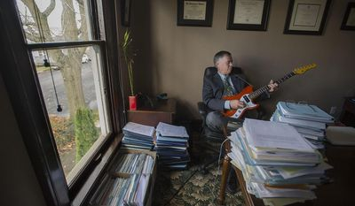 In this Tuesday, Nov. 15, 2016 photo, Michael Green, a criminal defense attorney and musician, is pictured in his office in downtown Vancouver, Wash. (Amanda Cowan /The Columbian via AP)