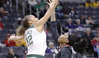 Baylor guard Alexis Prince, left, blocks a shot by Texas Tech guard Ivonne CookTaylor, right, during the first half of an NCAA college basketball game at the Big 12 Conference tournament Saturday, March 4, 2017, in Oklahoma City. (AP Photo/Alonzo Adams)