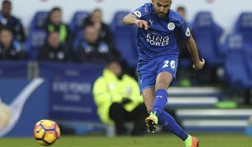 Leicester City's Riyad Mahrez scores his sides second goal during their English Premier League match against Hull City at the King Power Stadium, Leicester, England, Saturday, March 4, 2017. (Steve Paston/PA via AP)