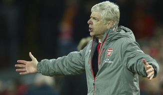 Arsenal's manager Arsene Wenger reacts to a decision by the referee during the English Premier League soccer match between Liverpool and Arsenal at Anfield, in Liverpool, England, Saturday, March 4, 2017.(AP Photo/Dave Thompson)