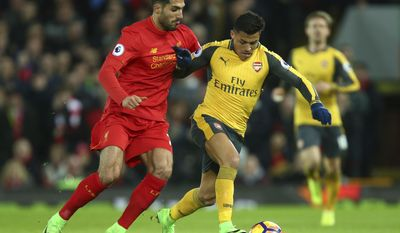 Arsenal's Alexis Sanchez, right, holds off the challenge of Liverpool's Emre Can during the English Premier League soccer match between Liverpool and Arsenal at Anfield, in Liverpool, England, Saturday, March 4, 2017.(AP Photo/Dave Thompson)