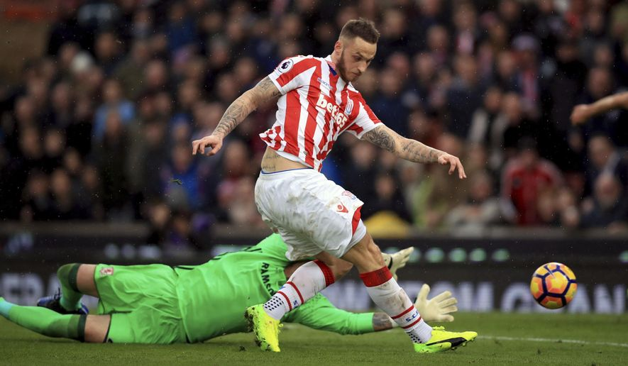 Stoke City's Marko Arnautovic scores his side's first goal of the game during their English Premier League soccer match against Middlesbrough at the bet365 Stadium, Stoke, England, Saturday, March 4, 2017. (Mike Egerton/PA via AP)