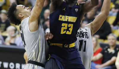 California guard Jabari Bird, center, goes up for a basket as Colorado guards Derrick White, left, and Xavier Johnson defend in the first half of an NCAA college basketball game Saturday, March 4, 2017, in Boulder, Colo. (AP Photo/David Zalubowski)