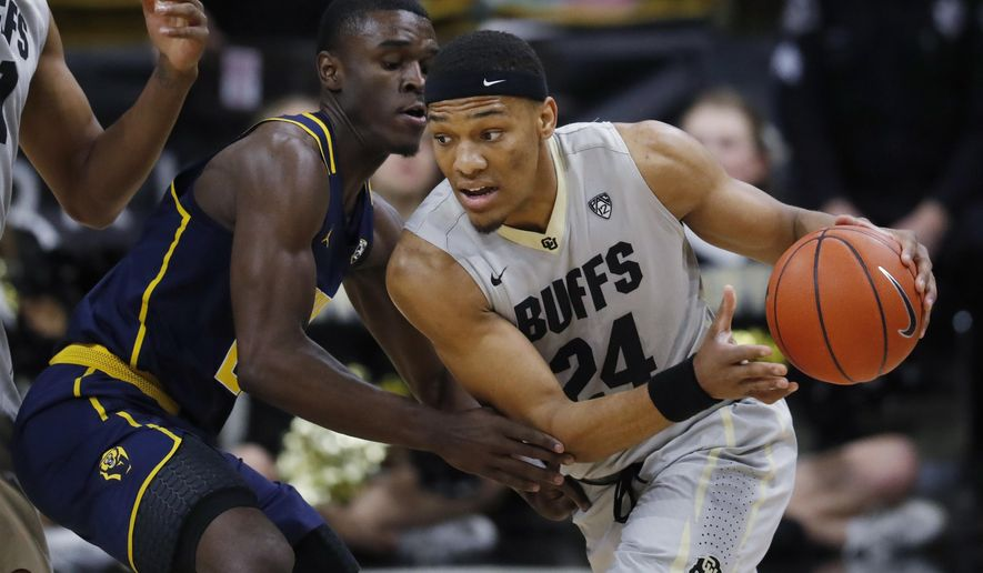 Colorado guard George King, right, drives the lane past California guard Jabari Bird during the first half of an NCAA college basketball game, Saturday, March 4, 2017, in Boulder, Colo. (AP Photo/David Zalubowski)