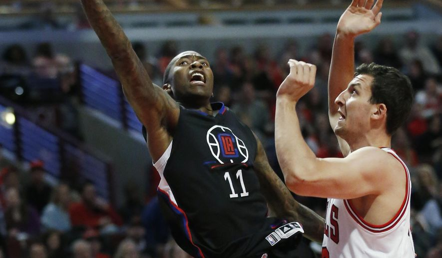 Los Angeles Clippers guard Jamal Crawford, left, drives to the basket against Chicago Bulls forward Paul Zipser during the first half of an NBA basketball game Saturday, March 4, 2017, in Chicago. (AP Photo/Nam Y. Huh)