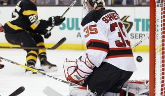 Boston Bruins' Brandon Carlo (25) scores on New Jersey Devils' Cory Schneider (35) during the second period of an NHL hockey game in Boston, Saturday, March 4, 2017. (AP Photo/Michael Dwyer)