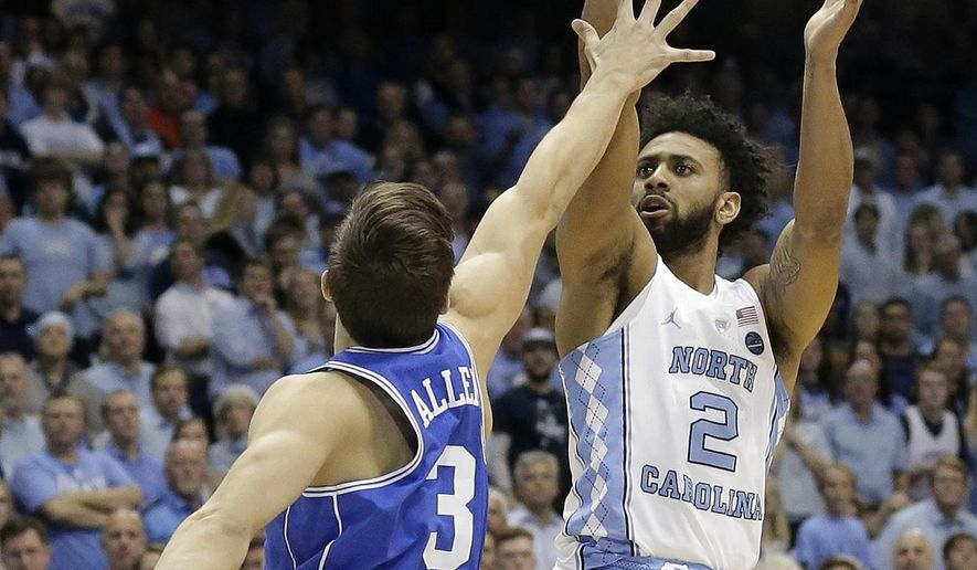 North Carolina's Joel Berry II (2) shoots over Duke's Grayson Allen (3) during the first half of an NCAA college basketball game in Chapel Hill, N.C., Saturday, March 4, 2017. (AP Photo/Gerry Broome)
