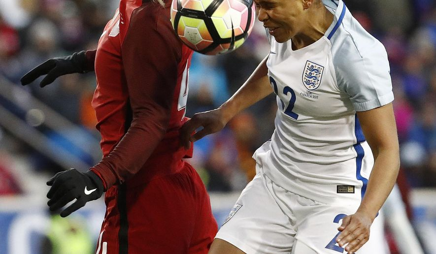 United States defender Becky Sauerbrunn, left, and England forward Nikita Parris (22) go up for the ball during the first half of a SheBelieves Cup women's soccer match, Saturday, March 4, 2017, in Harrison, N.J. (AP Photo/Julio Cortez)