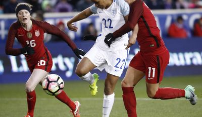 England forward Nikita Parris (22) rushes toward the net as United States defender Ali Krieger (11) closes in during the first half of a SheBelieves Cup women's soccer match, Saturday, March 4, 2017, in Harrison, N.J. (AP Photo/Julio Cortez)