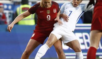 United States midfielder Lindsey Horan (9) defends against England midfielder Jordan Nobbs (7) during the first half of a SheBelieves Cup women's soccer match, Saturday, March 4, 2017, in Harrison, N.J. (AP Photo/Julio Cortez)