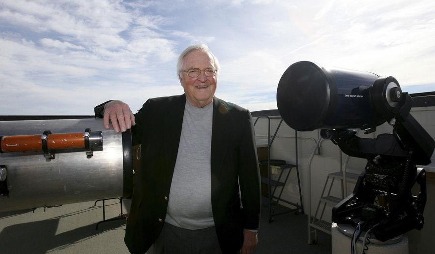 In this Friday, Feb. 10, 2017 photo, Clyde Sachtleben poses at the observatory that bears his name in Hastings, Neb. Clyde Sachtleben, 80, has vacated his familiar part-time role as J-Term astronomy teacher and made his retirement permanent after serving 41 years as full-time head of the physics department through 2001. (Amy Roh/The Hastings Tribune via AP)